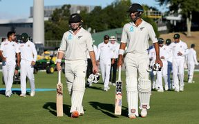 Century makers Jeet Raval and Tom Latham.