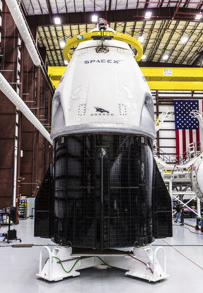 SpaceX's Crew Dragon spacecraft and Falcon 9 rocket are positioned inside the company's hangar at Launch Complex 39A at NASA's Kennedy Space Center in Florida.