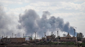 Smoke billows after shelling on the IS group's last holdout of Baghuz.