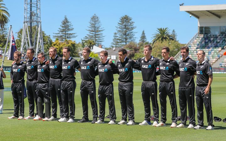 The Black Caps sing the national anthem.