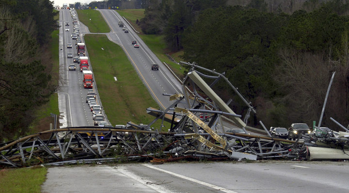 A fallen cell tower lies across U.S. Route 280 highway in Lee County, Ala., in the Smiths Station community after what appeared to be a tornado struck in the area.