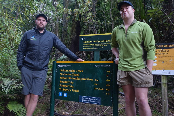 Taranaki Mounga project  manager Sean Zieltjes with DOC field ranger Cody on the Mounga.