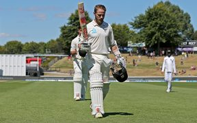 New Zealand captain Kane Williamson leaves the field after scoring his double hundred.