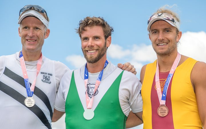 Mahe Drysdale (lelt) , Robbie Manson (centre) and Jordan Parry on the podium after the men's single scull at the national champs in February.