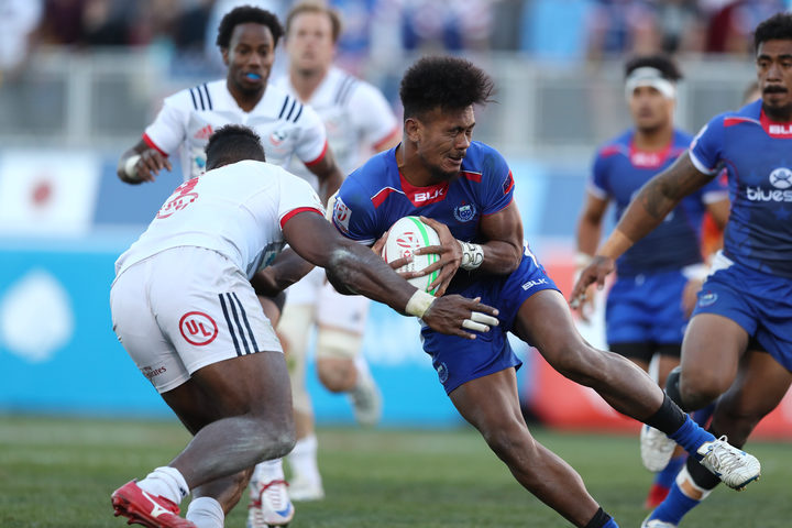 Samoa's Joe Perez challenges the USA defence during the Cup final in Las Vegas.