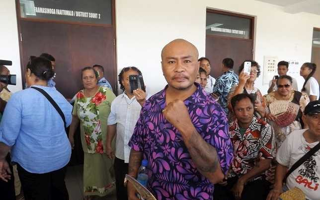 Talalelei Pauga and supporters outside court in Apia