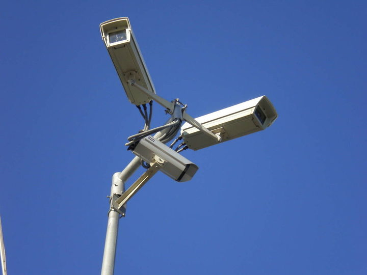 Three video surveillance cameras on a stand