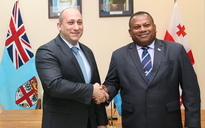Fiji's Minister for Defence, National Security and Foreign Affairs, Inia Seruiratu (R) and the Georgian Deputy Minister of Foreign Affairs, Alexander Khvtisiashvili