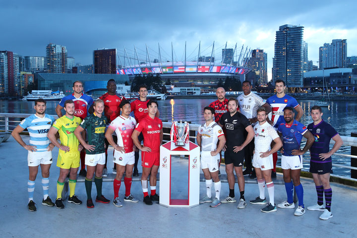 The captains pose with the trophy prior to the start of the USA Sevens.