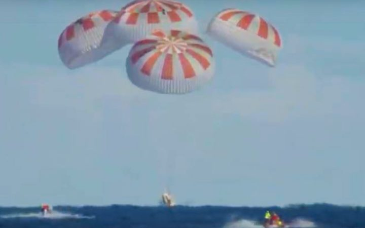 This video grab taken from the Nasa - Space X webcast transmission on March 8, 2019, shows SpaceX Dragon capsule successfully splashed down in the Atlantic Ocean today after more than six days in space, completing its demonstration mission for US space agency NASA.