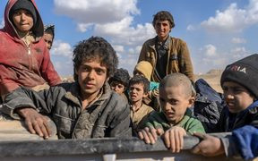 Children who were captured by Islamic State (IS) group fighters, believed to be from the Yazidi community, are pictured after being evacuated from the IS' embattled holdout of Baghouz