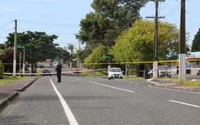 Police guard the scene where a man died early Sunday morning