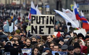 "A protester holds a placard reading ""Putin - No!"" during an opposition rally in central Moscow, on March 10, 2019, to demand internet freedom in Russia."