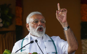 Indian Prime Minister Narendra Modi gestures during a National Democratic Alliance (NDA) rally in Chennai