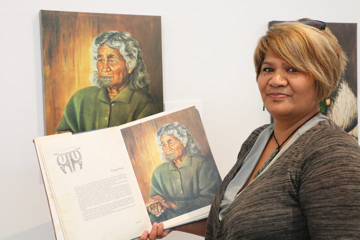 Caline Ruri-Kerr with the 1980 first edition copy of The Blue Privilege - The Last Tattooed Māori Women Te Kuia Moko.