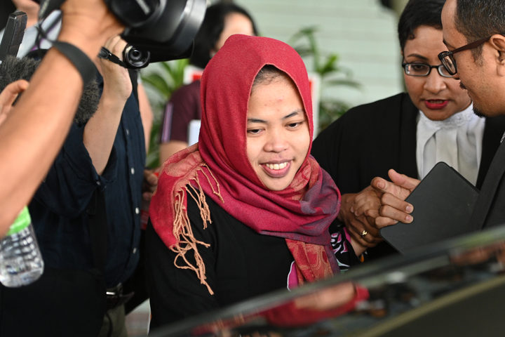 Indonesian national Siti Aisyah (C) smiles while leaving the Shah Alam High Court, outside Kuala Lumpur on March 11, 2019 after her trial for her alleged role in the assassination of Kim Jong-nam.