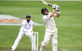 Ross Taylor hits a six to bring up his century, on his way to 200 in the first test between the New Zealand Black Caps and Bangladesh.