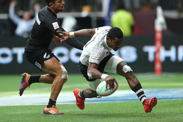 Fiji's Aminiasi Tuimaba scores a try against New Zealand in their quarter final clash in Vancouver.