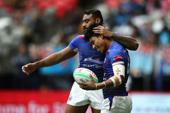 Samoa captain David Afamasaga and Murphy Paulo celebrate a try.