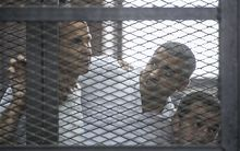 Peter Greste (left) Mohamed Fahmy and Baher Mohamed listen to the verdict.