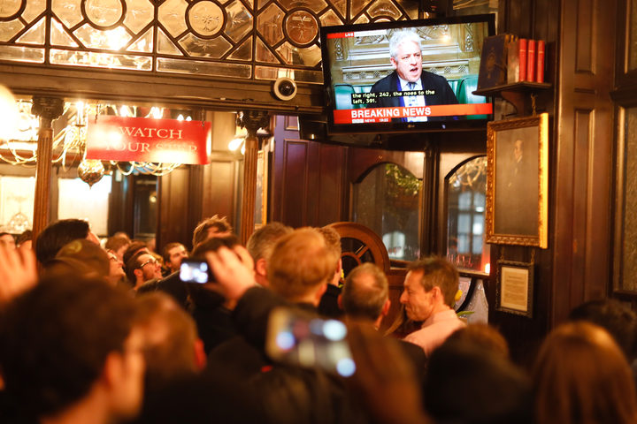 Pubgoers watch a television screen in Whitehall as John Bercow, Speaker of the House declares that Prime Minister Theresa May's Brexit deal was defeated by 149 votes in an historic parliamentary vote on March 12, 2019.