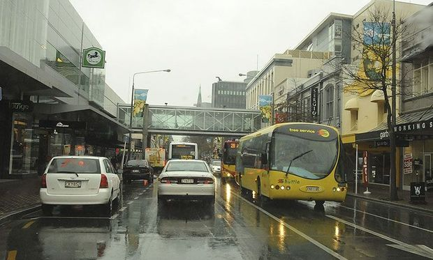 A 2008 picture of traffic, including buses, on Colombo Street prior to the earthquakes of 2010 - 2011.