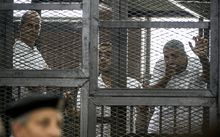 Peter Greste, left, Mohamed Fadel Fahmy and Baher Mohamed at the sentencing.