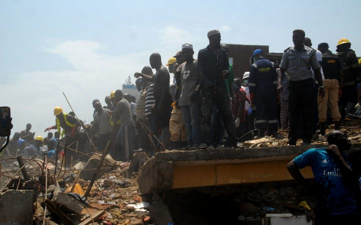 Emergency personnel at the site of a school building which collapsed in Lagos on March 13, 2019.