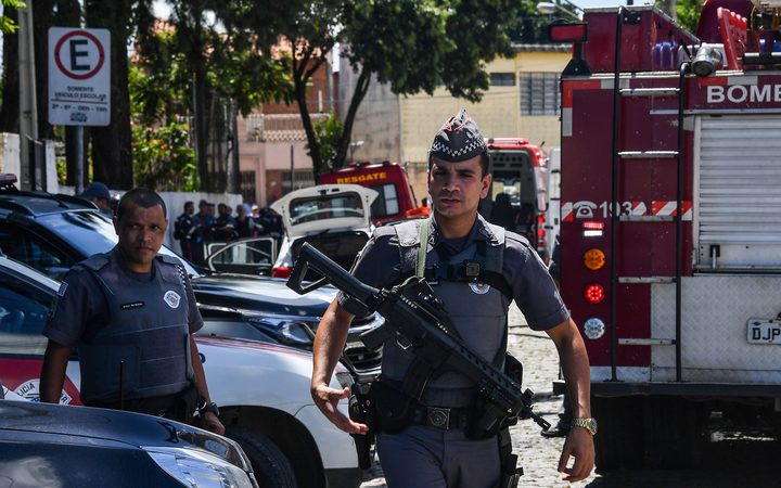 Police work at the scene of a shooting at a school in Suzano, Sao Paulo metropolitan region, Brazil.