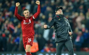 Jordan Henderson of Liverpool and Liverpool manager Jurgen Klopp react to a goal.