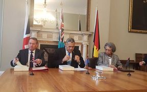 The British international trade secretary, Liam Fox, with Jitoko Tikolevu and Winnie Kiap, the high commissioners to the UK for Fiji and Papua New Guinea, signing a post-Brexit trade deal, 14 March 2019.