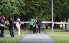 Police taping off the street out Christchurch mosque, families reunite