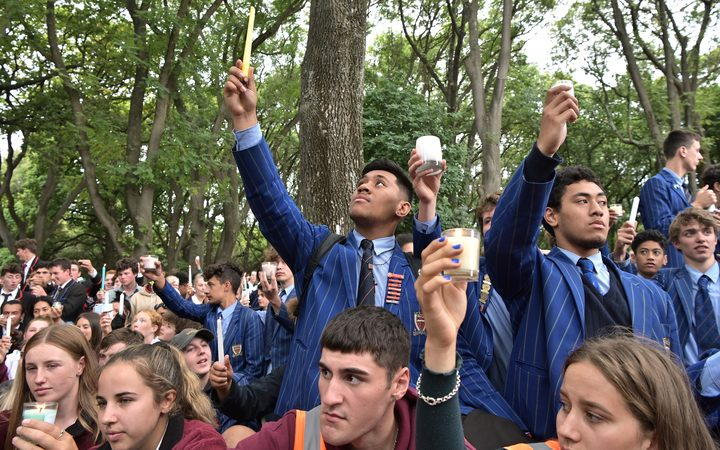 Young students attend a vigil in Christchurch today.