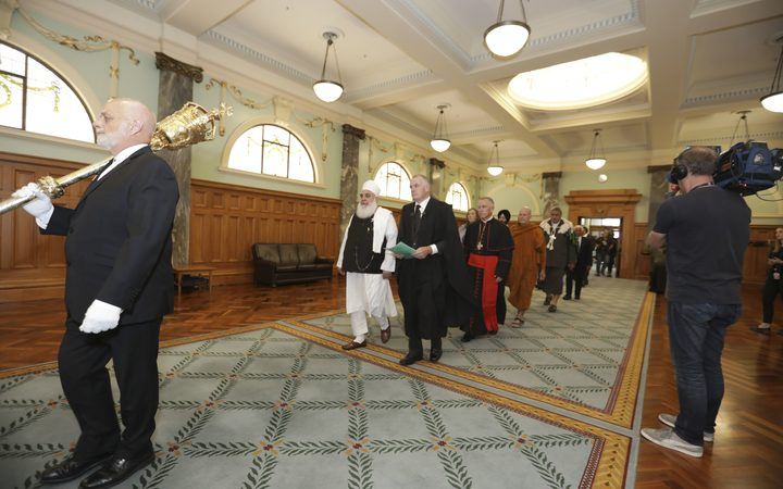 Imam Nizam ul haq Thanvi and Trevor Mallard lead a multi-faith procession into The House.