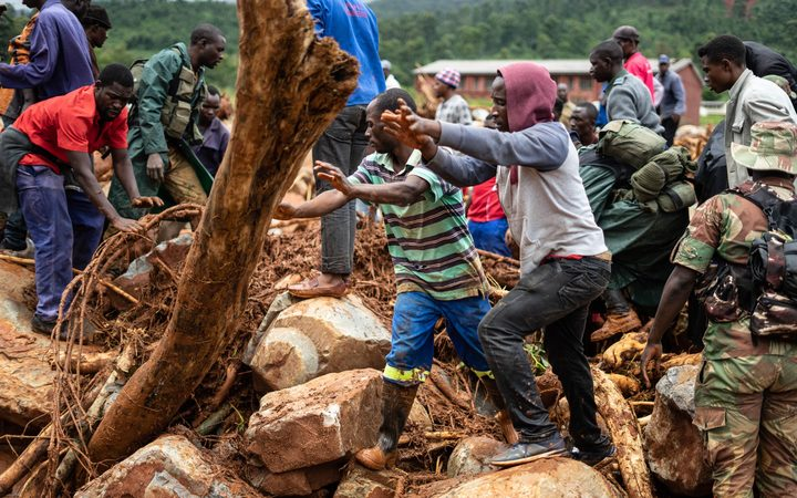 People search for survivors in Ngangu township Chimanimani, Manicaland Province, eastern Zimbabwe after the area was hit by the cyclone Idai.