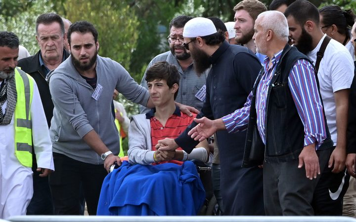 Zaid Mustafa (in wheelchair), who was wounded by the gunman, attends the funeral of his slain father Khaled Mustafa and brother Hamza Mustafa at the Memorial Park cemetery in Christchurch  today.