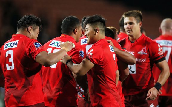 The Sunwolves celebrate their upset win over the Chiefs in Hamilton.