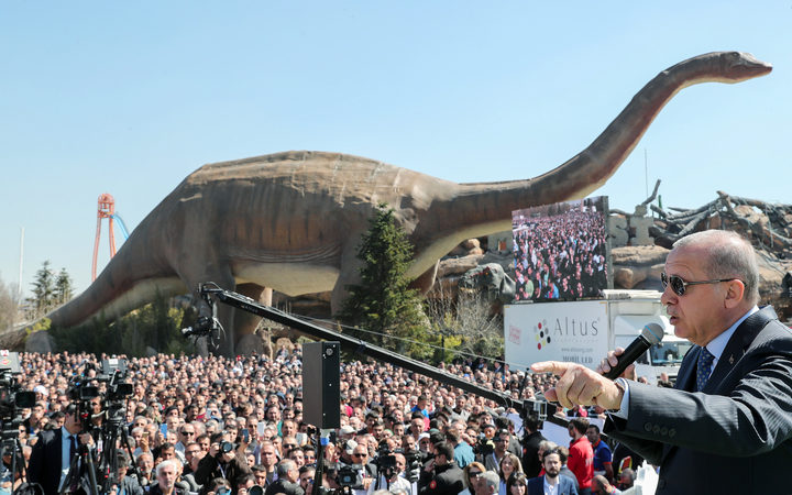 Turkish President Recep Tayyip Erdogan speaking next to a model dinosaur during the opening ceremony of the Wonderland Eurasia theme park in Ankara.