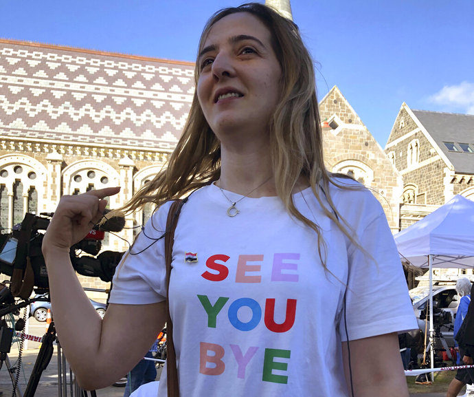 Aya Al-Umari wears the T-shirt that her brother, Hussein Al-Umari, 35, teased her about the last time she saw him, before he was killed on March 15 in the attack at the Al Noor mosque in Christchurch, New Zealand, Tuesday, March 19, 2019. (AP Photo/Juliet Williams)