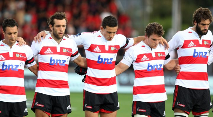 Sam Whitelock (right) and fellow Crusaders players remember the victims of the Pike River and Christchurch Earthquake ahead of a match at  Trafalgar Park in Nelson in 2011.