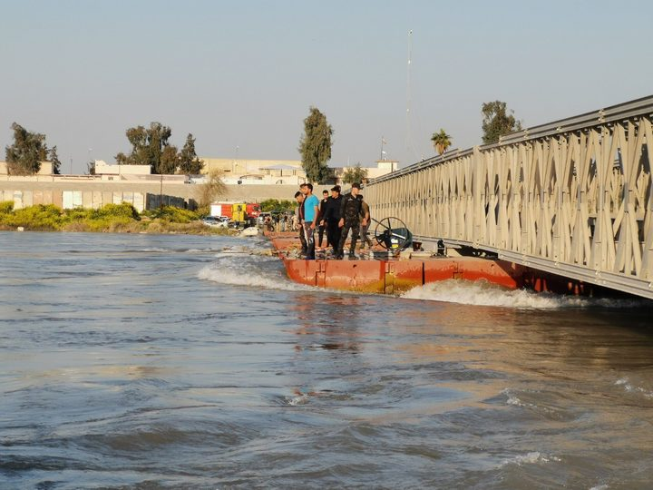 MOSUL, IRAQ - MARCH 21: Search and rescue operations are being carried out around the site after a ferryboat sank in Iraqs Tigris River on Thursday, leaving at least 72 people dead in Mosul, Iraq. The ferryboat was reportedly carrying 170 passengers when it sank near Mosul.