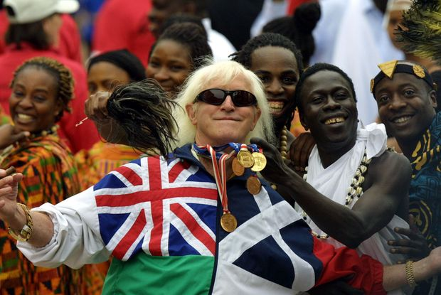 Jimmy Saville at the Queen's Golden Jubilee in June 2002, Buckingham Palace forecourt.