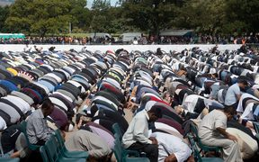 Muslims prostrate towards Mecca during congregational Friday prayers led by Gamal Fouda, imam of the tragedy-stricken Al Noor mosque.