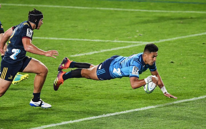 Rieko Ioane scores an early try for the Blues.