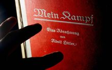 A signed copy of a first edition Mein Kampf on display at a London auction house.