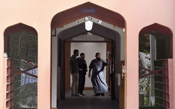Members of the local Muslim community inspect the interior of the Al Noor Mosque after it was reopened.