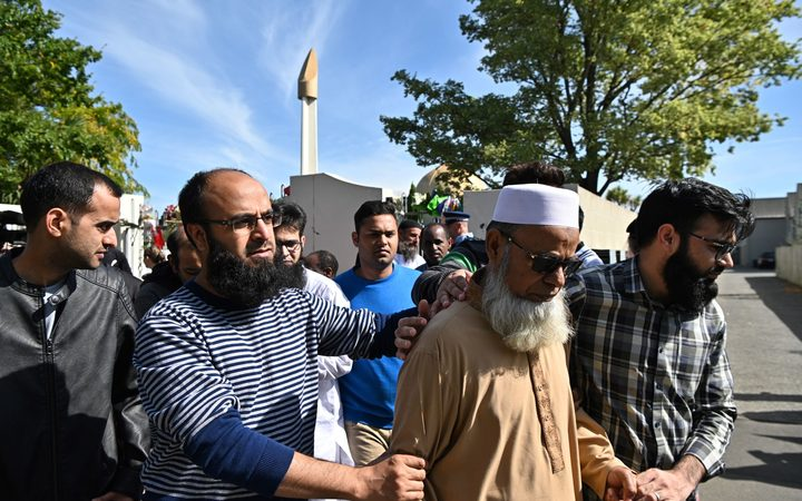 Members of the Muslim community leave the Al Noor Mosque in Christchurch, after it was opened to members of the public in groups of 15 at a time.