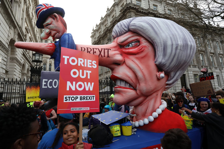 A puppet head of Britain's Prime Minister Theresa May spearing a representation of the British Economy is positioned on Whitehall outside Downing Street.