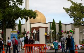 People gather outside Al Noor Mosque