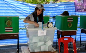 A woman casts her ballot at a polling station in Bangkok on March 24, 2019, during Thailand's general election.